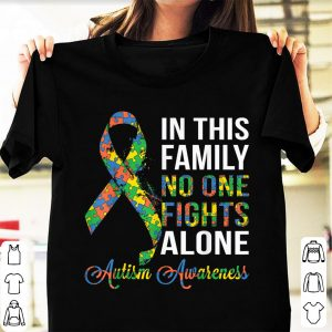 Premium In This Family No One Fights Alone Autism Warreness shirt