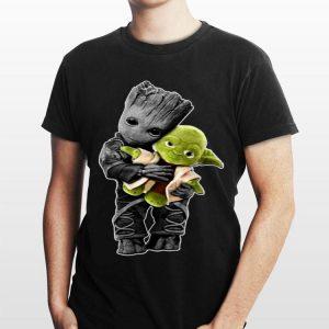 Baby Groot hugging Baby Yoda sweater