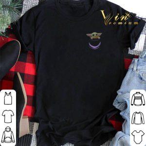 Baby Yoda in pocket shirt sweater
