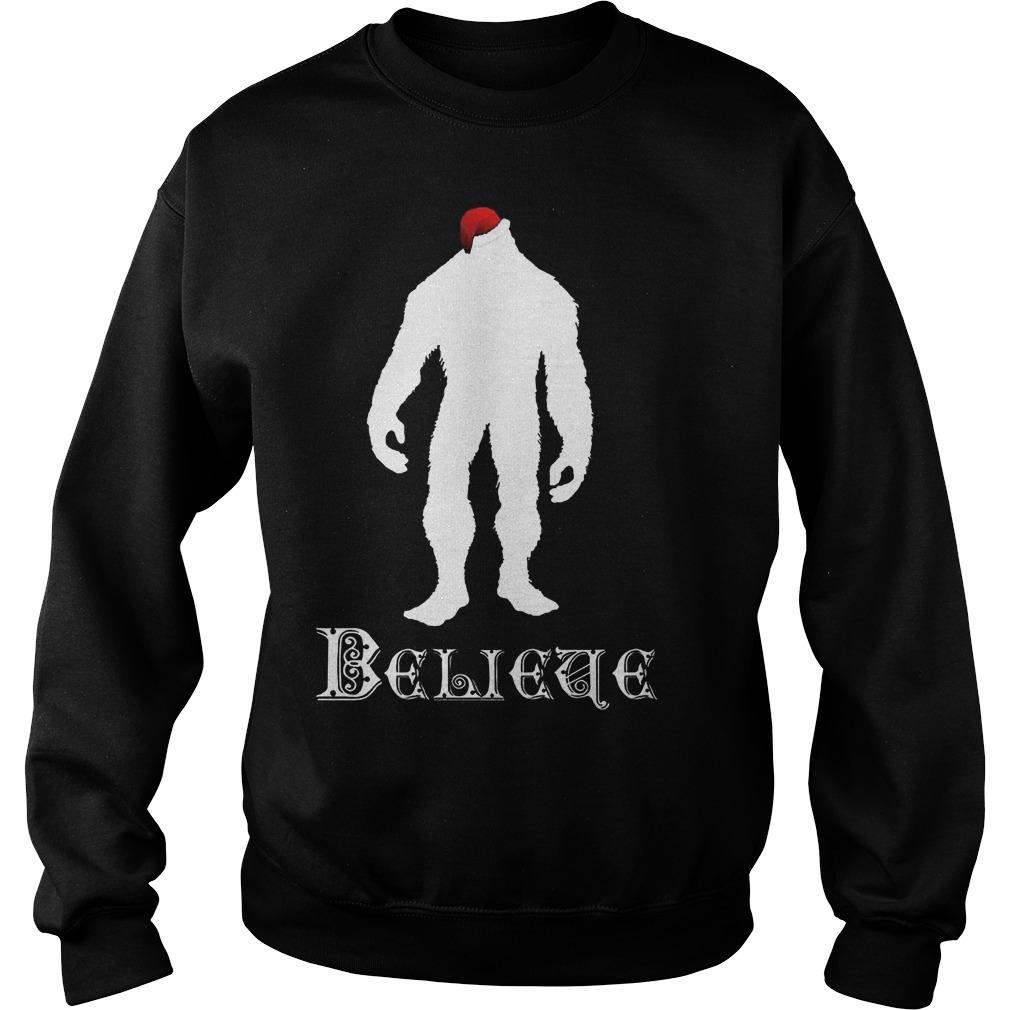 d95ca490db Believe christmas bigfoot in santa hat shirt