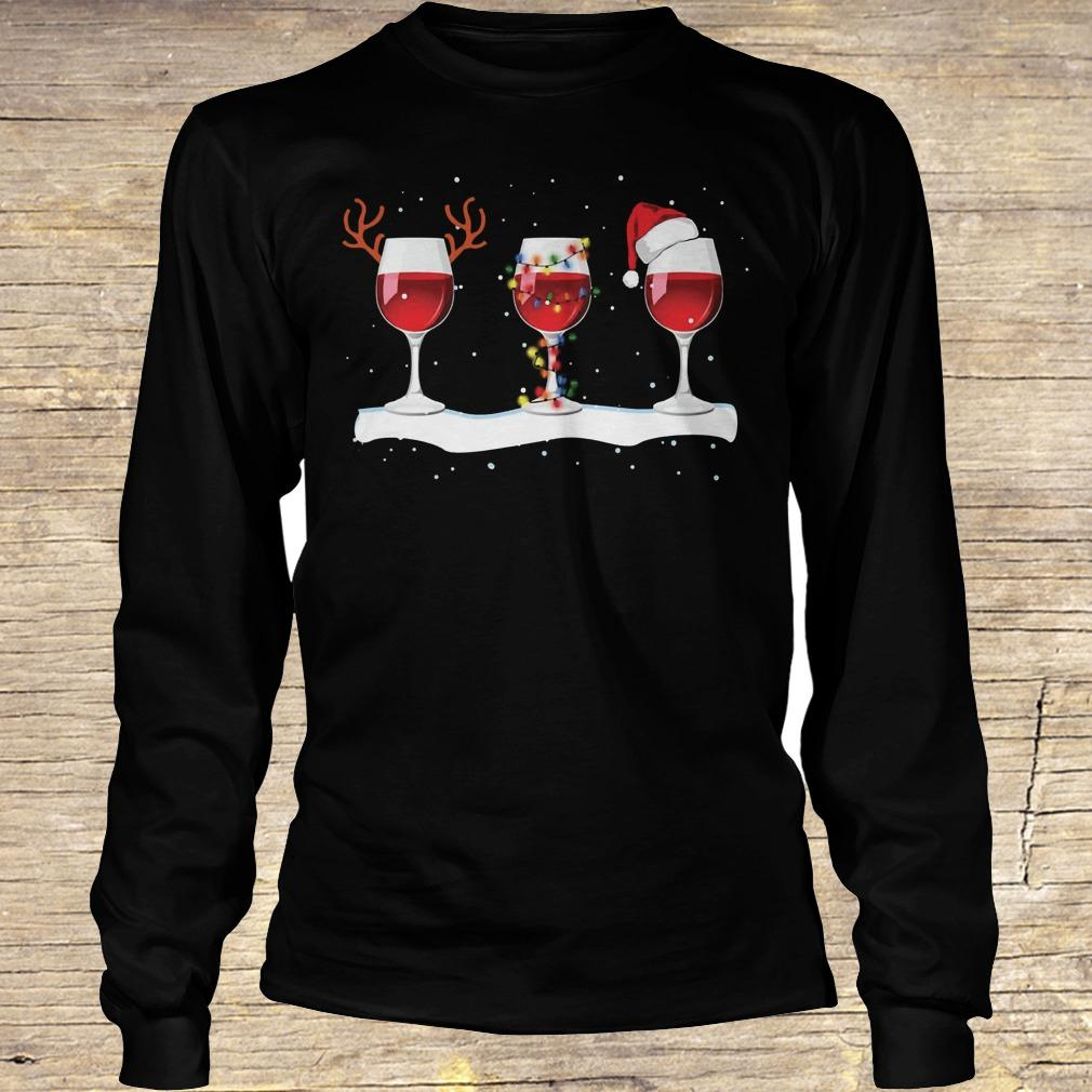0a6ae30df57ac Three wine glasses with Christmas light