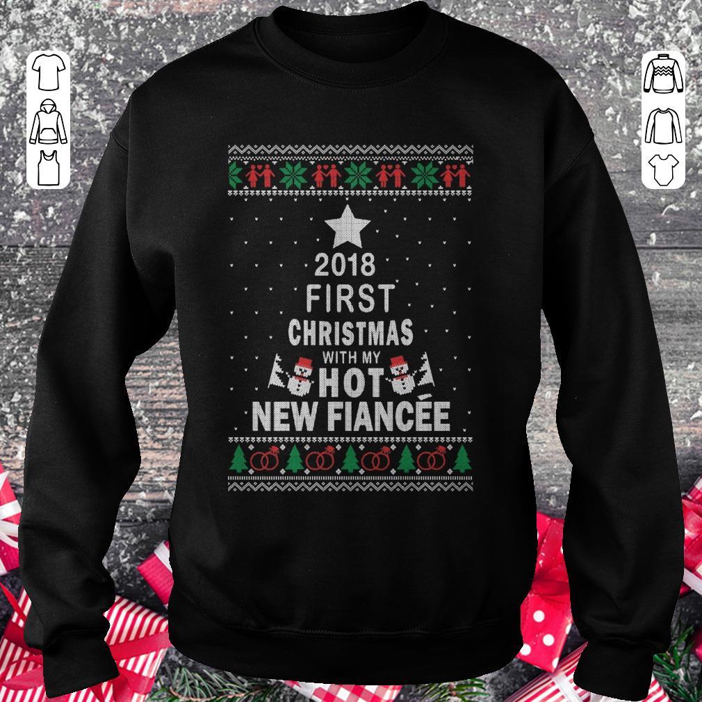 https://kuteeboutique.com/wp-content/uploads/2018/11/Premium-2018-First-christmas-with-my-hot-new-fiance-shirt-Sweatshirt-Unisex.jpg