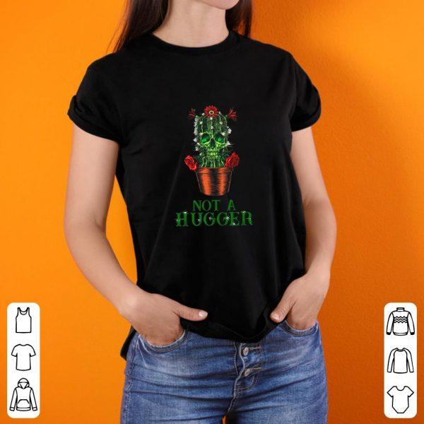 Top St Patrick's Day Skull Not A Hugger Cactus shirt