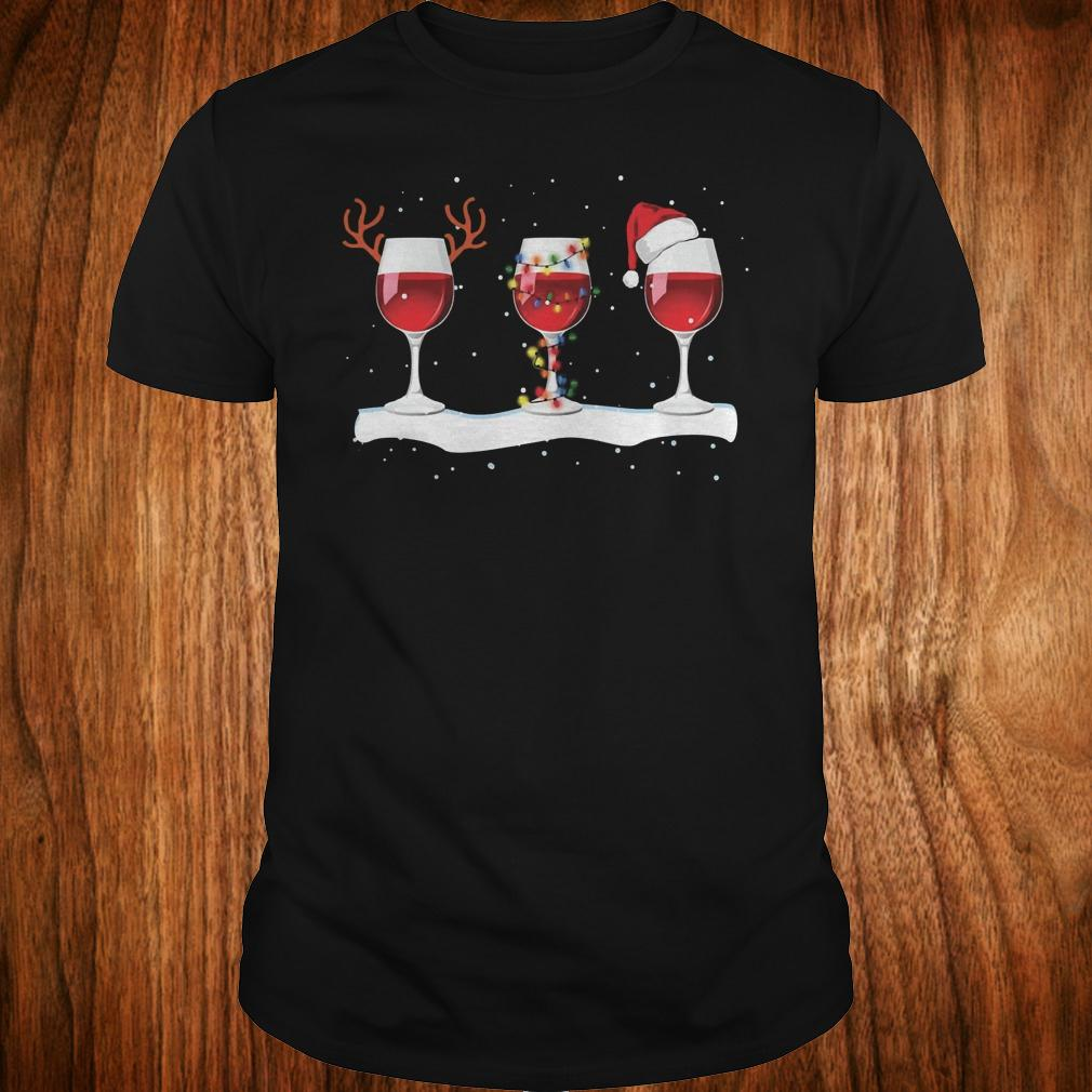 Three wine glasses with Christmas-light deer horn and Santa hat shirt