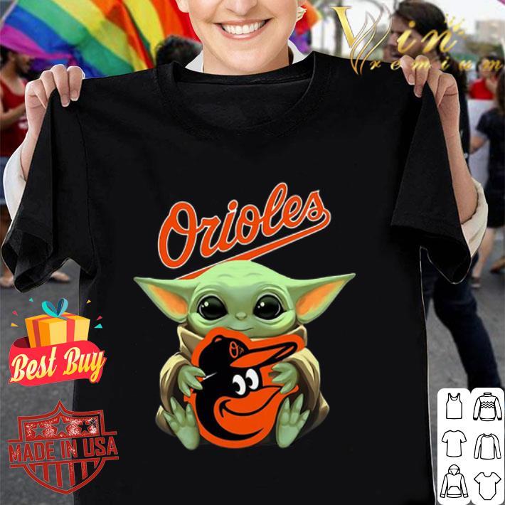 - Baby Yoda hug Baltimore Orioles Star Wars Mandalorian shirt