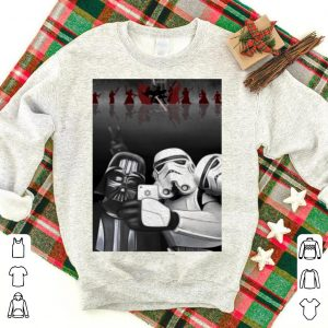 Darth vader and stormtroopers take a selfie in Star Wars shirt