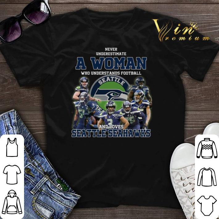 online store 82d52 a7467 Never underestimate a woman who understands Seattle Seahawks shirt sweater