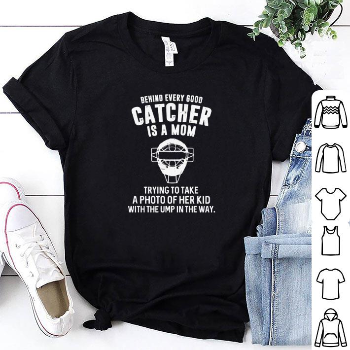 Behind every good catcher is a mom trying to take a photo of her kid shirt