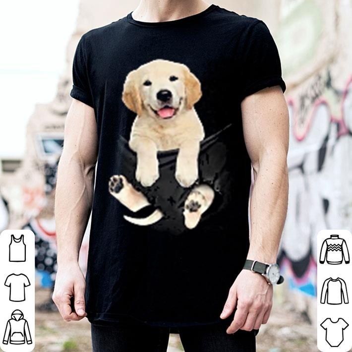 Golden Retriever in pocket shirt